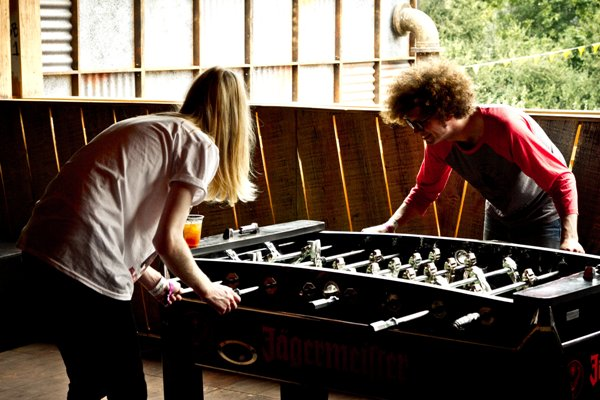 10. Luke and Jazz struggle to play table football.